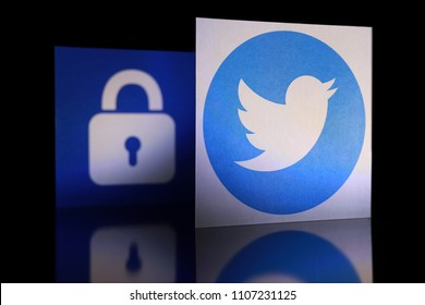 PENANG, MALAYSIA - APRIL 25, 2018: Twitter security and privacy issues. Close up Twitter logo with security lock icon behind it on black background