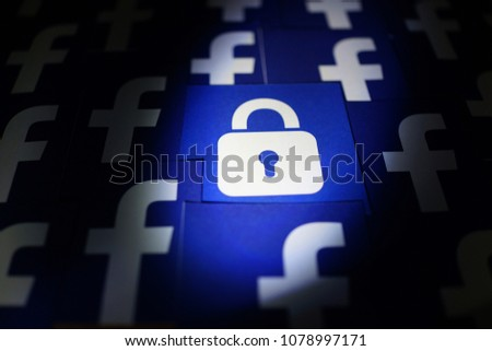 PENANG, MALAYSIA - APRIL 25, 2018: Facebook security and privacy issues. Close up security lock icons with Facebook logo surrounded it.