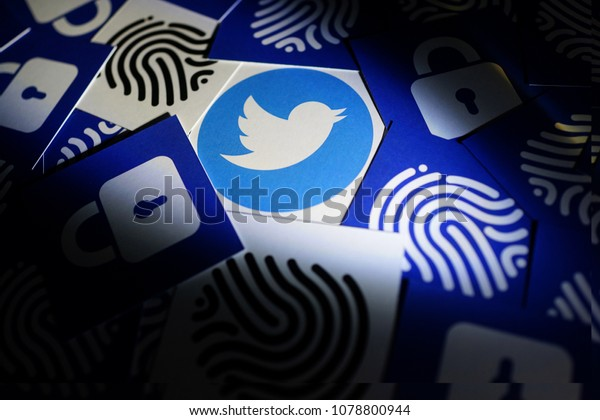 PENANG, MALAYSIA - APRIL 25, 2018: Twitter security and privacy issues. Close up Twitter logo with security lock and thumb print icons surrounded it.