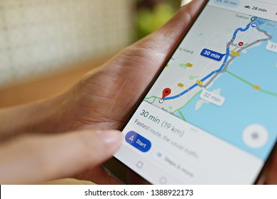 Penang, Malaysia - April 3, 2019: Using Google Maps service on smartphone at cafe. Google Maps is most popular mapping service for mobile provided by Google.