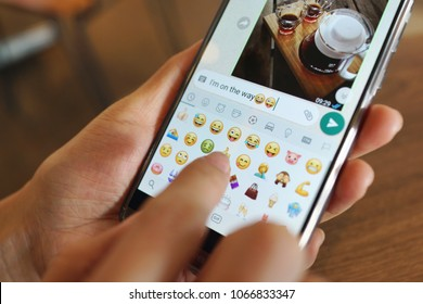 PENANG, MALAYSIA - April 6, 2018: Girl with smartphone in her hands and a whatsapp conversation on the screen. Young woman, millennial, chatting. Technology. Communications.