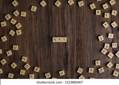 Penang, Malaysia. Aug 12, 2019. The word 'VAT' spelled out with scrabble, isolated on wooden background, presentation background, tax concept, finance concept - Image