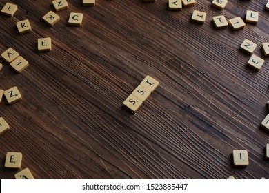 Penang, Malaysia. Aug 12, 2019. The word 'SST' spelled out with scrabble, isolated on wooden background, presentation background, SST concept, finance concept - Image