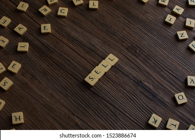 Penang, Malaysia. Aug 12, 2019. The word 'Sell' spelled out with scrabble, isolated on wooden background, presentation background,sell concept, buy and sell concept, property market concept - Image