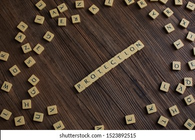 Penang, Malaysia. Aug 12, 2019. The word 'Protection' spelled out with scrabble, isolated on wooden background, presentation background, insurance concept, protection concept - Image