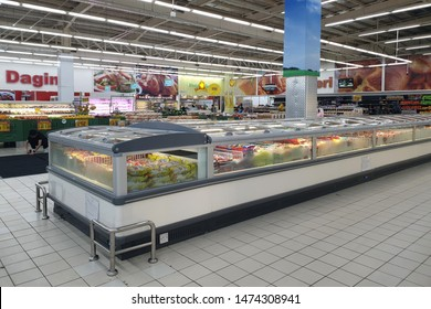 PENANG, MALAYSIA - AUG 2, 2019: Interior view of huge glass freezer with various brand frozen food in Giant store. Giant is a famous and trusted supermarket brand in Malaysia.