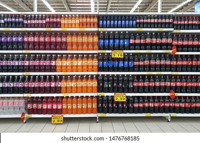 PENANG, MALAYSIA - AUG 2, 2019: Rows of shelves carbonated drinks in Giant Store. Giant Malaysia is a trusted supermarket brand that offers the finest selection local and imported quality products.