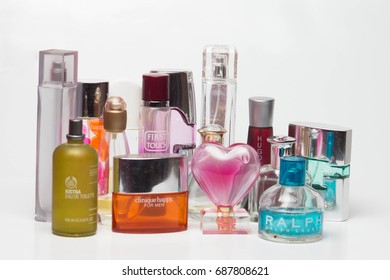 PENANG, MALAYSIA - AUG 2017 :Used perfume bottles from various products isolated on white background.