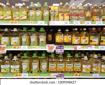 PENANG, MALAYSIA - AUG 26, 2019: Rows of high quality healthy cooking oil made from Sunflower on a store shelf. Sunflower Oil is a highly stable cooking oil that is suitable for cooking and baking.