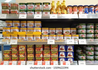 PENANG, MALAYSIA - AUG 26, 2019: Various brand imported canned cooked pork meat display on store shelf.