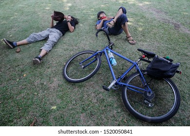 Penang, Malaysia - August 20,2019. a group Touring bicycle  take a rest before continue riding at Penang Island, Malaysia. Hikers with bikes.Sports and cycling,healthy lifestyle.Traveling on bikes