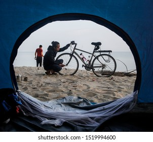 Penang, Malaysia - August 20,2019.  man checking his bicycle before riding at Penang Island, Malaysia. Hikers with bikes.Sports and cycling,healthy lifestyle.Traveling on bikes