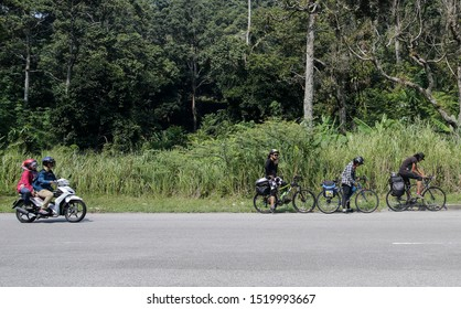 Penang, Malaysia - August 20,2019. Touring bicycle riding at Penang Island, Malaysia. Hikers with bikes.Sports and cycling,healthy lifestyle.Traveling on bikes