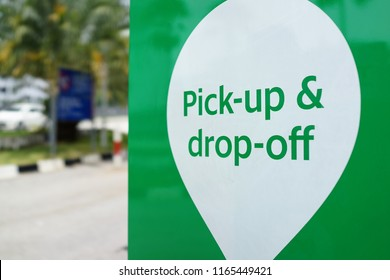 PENANG, MALAYSIA - AUGUST 27, 2018 : Grab car pick up and drop off sign beside shopping mall. Grab is a Singapore based company that offers ride-hailing and logistics services through its app.