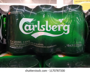 PENANG, MALAYSIA - AUGUST 27, 2018: Carlsberg cans beer on grocery store shelf, Penang. The Carlsberg is a Danish brewing company founded in 1847, headquarters located in Copenhagen, Denmark.