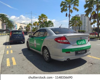 PENANG, MALAYSIA - AUGUST 3, 2018: Grab car service in Penang, Malaysia. Grab is a Singapore based company that offers ride-hailing and logistics services through its app.