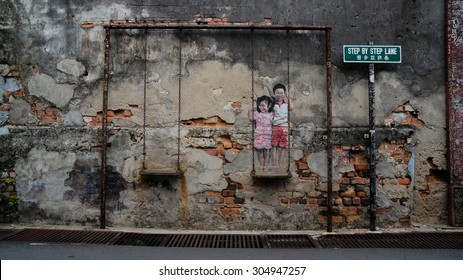 PENANG, MALAYSIA - AUGUST 5, 2014: Street Mural tittle 'Children on the Swing' painted by Louis Gan in Penang on July 6, 2013.