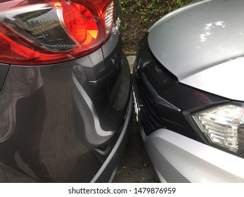 Penang, Malaysia - August 9, 2019 : Two cars parking literally bumper to bumper at a parking lot at Pulau Tikus