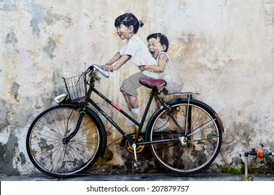 PENANG, MALAYSIA- circa JULY 2013: Street Mural tittle 'Little Children on a Bicycle' painted by Ernest Zacharevic in Penang.