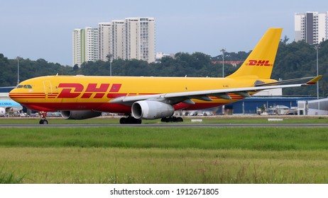 Penang, Malaysia- Dec 12 2020: A DHL A330 carrying cargo to Penang International Airport.
