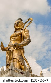 Penang, Malaysia - Dec 9, 2017: Warrior guardian statue at Kek Lok Si Buddhist temple in Penang. It is said to be the largest Buddhist temple in Malaysia.