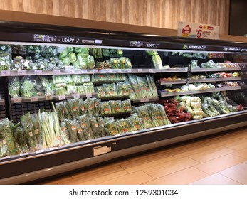 Penang, Malaysia - December 16, 2018 : Assorted fresh organic vegetables for sale on shelves at Aeon Queensbay mall