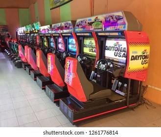 Penang, Malaysia - December 19, 2018 : View of a row of Daytona racing arcade machines inside an arcade shop at Gurney Plaza penang