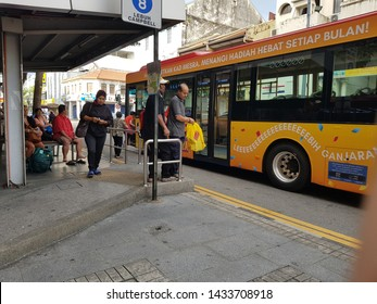 Penang, Malaysia. December 2, 2018. Locals mainly elderly waiting at bus stop  despite lesser people still using bus as public transport with the growth of e-hailing transportation means