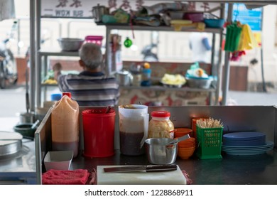 Penang, Malaysia - December 2016: Asian street food restaurant kitchen in Georgetown, Penang, Malaysia. Georgetown is famous for its street food culture.