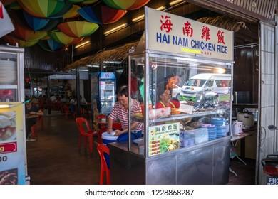 Penang, Malaysia - DECEMBER 2016: Chinese street food restaurant vendor in Georgetown, Penang, Malaysia. Georgetown is famous for its street food culture.