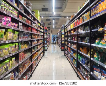 Penang, Malaysia - December 26, 2018 : Assorted junk food packets arranged in shelves for sale at Jaya Grocery Gurney Paragon