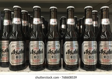 Penang, Malaysia - December 3, 2017 : Asahi beer in a row on a supermarket shelf. Asahi is one of the more popular beer from Japan
