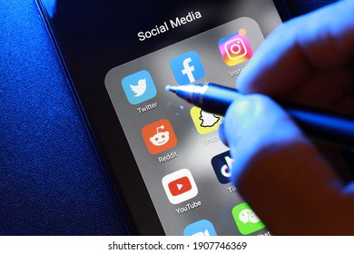 PENANG, MALAYSIA - FEB 1, 2021: User using Twitter mobile application on an Android smartphone screen. Twitter is an American online news and social networking service.
