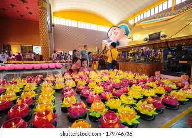 PENANG, MALAYSIA- FEB 2, 2014 : A mother and her daughter looking at a table full of prayer lanterns in chayamangalaram, a famous siamese temple in Penang Malaysia during Chinese New Year 2014.