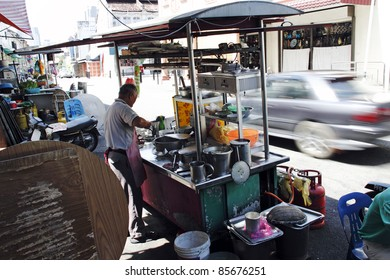 PENANG, MALAYSIA - FEBRUARY 12: A hawker at his beef ball noodle street stall on February 12, 2010 in Chulia Street, Penang, Malaysia. Penang is a world renown street hawker food tourist destination.