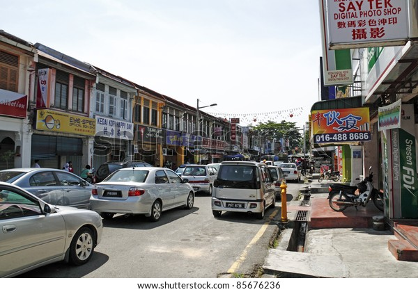 PENANG, MALAYSIA - FEBRUARY 13: Traffic congestion on February 13, 2010 in Jalan Air Hitam, Penang, Malaysia. The road leads to the largest buddhist temple in South East Asia called Kek Lok Si Temple.