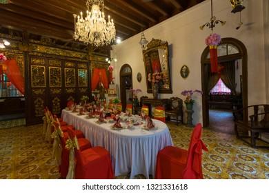Penang, Malaysia - February 13,2019 : Baba Nyonya traditional dining hall in the Pinang Peranakan Mansion in Penang, Malaysia on February 13,2019.