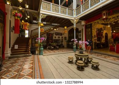 Penang, Malaysia - February 13,2019 : A traditional Nyonya inner courtyard at the Pinang Peranakan Mansion in Penang, Malaysia on February 13,2019. - Image