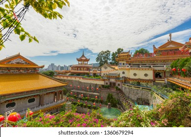 Penang, Malaysia - February 13,2019 : Yellow roof of Kek Lok Si Temple with Penang cityscape in Penang island, Malaysia on February 13,2019.