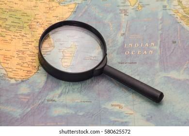 PENANG, MALAYSIA - FEBRUARY 2017 : Madagascar map and magnifying glass. Selective focus.