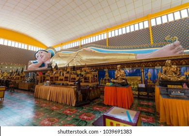 PENANG, MALAYSIA - FEBRUARY 4, 2018: Statue of Buddha in Nirvana at Wat Chayamangkalaram Temple in Penang, Malaysia. The statue in gold was built in 1958.
