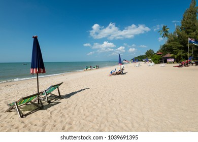 PENANG, MALAYSIA - FEBRUARY 4, 2018: Batu Ferringhi beach in Penang, Malaysia. Tourists are resting or are enjoying marine sports on the beach which is one of the most famous tourist attractions in Pe