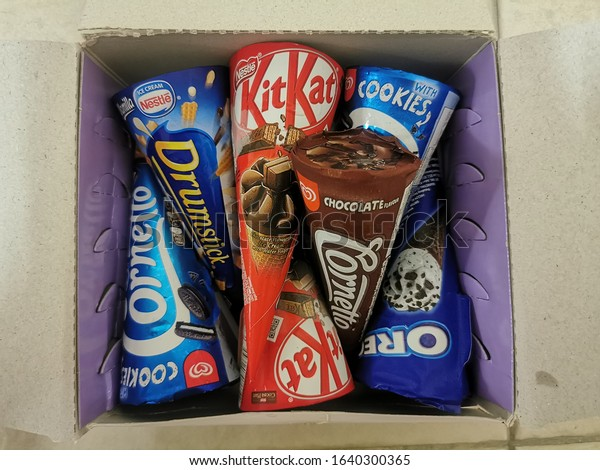Penang, Malaysia - Jan 19, 2020 : Assorted type of Kit Kat ice cream produced by Nestle & Wall inside a box.
