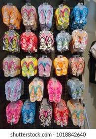 PENANG, MALAYSIA - January 05, 2018 - variety of SuperDry brand designer slippers, are placed on shelves & display in the concept store.
