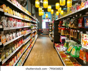 PENANG, MALAYSIA - January 12, 2018 - A variety brands of junk foods in boxes and can, potato chips, instant noodles and crackers , are placed on shelves & display in the asian grocery store.