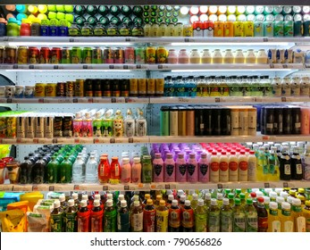 PENANG, MALAYSIA - January 12, 2018 - A variety brands of beverages, sparking water, fruits juice, are placed on shelves & display in the asian grocery store.