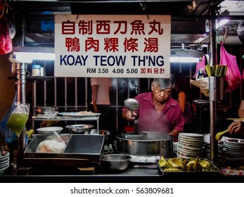 PENANG, MALAYSIA - JANUARY 2014: Street food vendor at the night market in Georgetown, Penang, Malaysia
