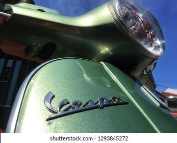 Penang, Malaysia - January 24, 2019 : Close up of the Vespa logo on a classic scooter bike at Pulau Tikus market