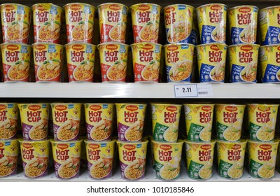 PENANG, MALAYSIA - JANUARY 27, 2018: Maggi instant cup noodles on store shelf.. Cup noodle are precooked instant noodles with seasoning sauce sold in a polystyrene cup.