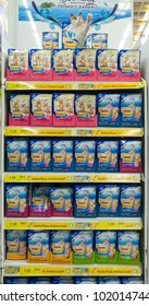 PENANG, MALAYSIA - January 5, 2018 - Rows of shelves with variety the taste of FRISKIES moist and dry cat food in plastic pack in a Grocery Store in a mall.